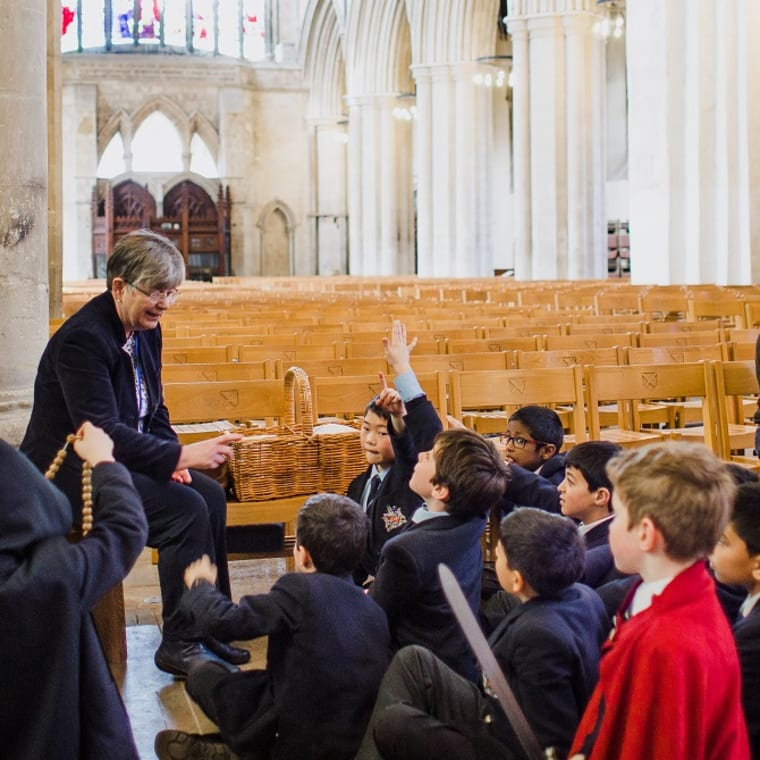 School children enjoying a lesson in St Albans Cathedral