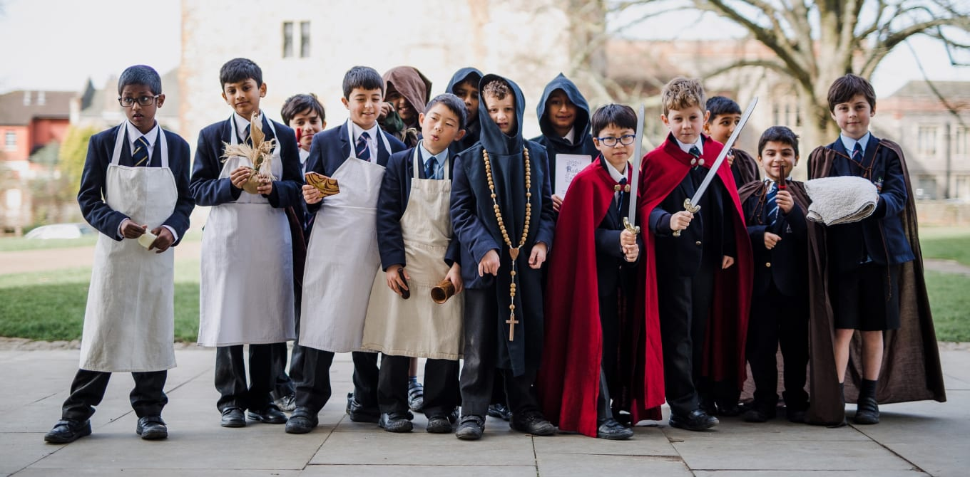 School pupils dressed up as medieval characters outside the Cathedral